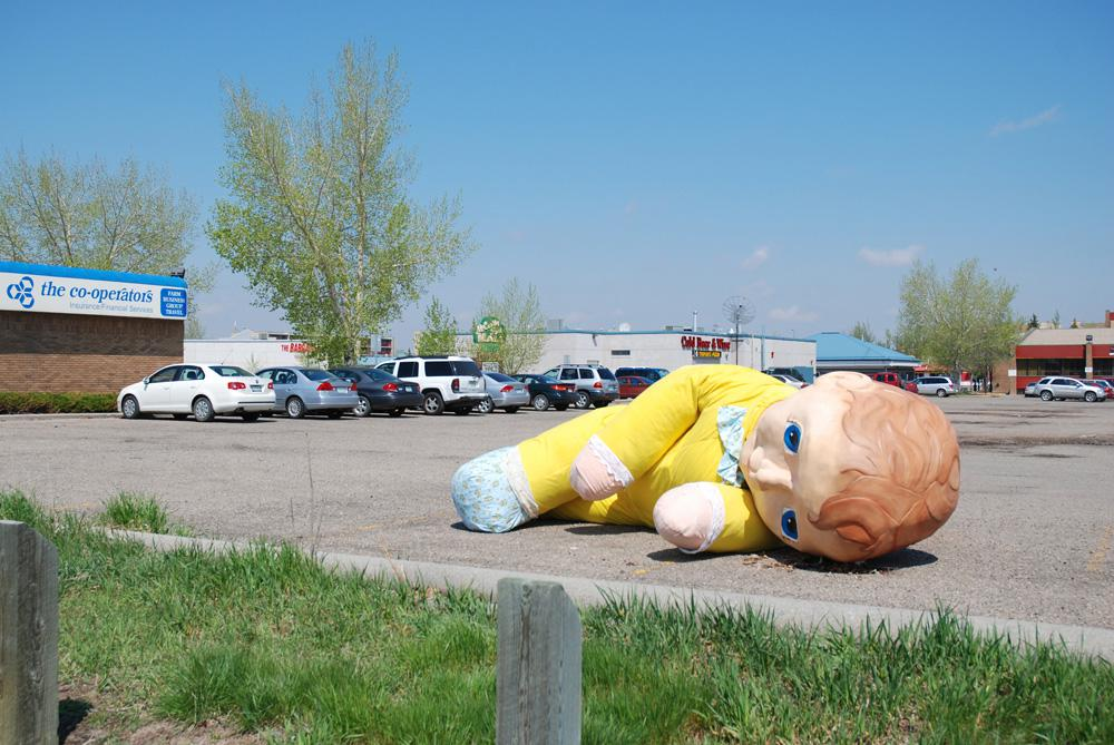 Heather Benningu0027s Four Metre Long Field Doll Installed Outdoors In Regina.  The Doll Is Based On A Toy Benning Has Had Since She Was Two.