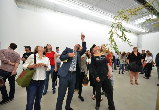 Guide Sky Gooden and participants look up with gallerist Clint Roenisch at the 2014 Toronto Gallery Hop. Photo: Nicola Betts.