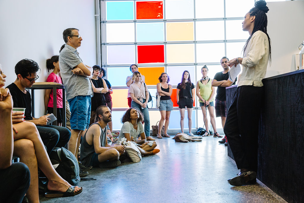 """<i>Canadian Art</i>'s associate editor Yaniya Lee discusses the """"Triangle Trade"""" exhibition at Gallery TPW, Toronto, 2017. Photo: Connie Tsang."""