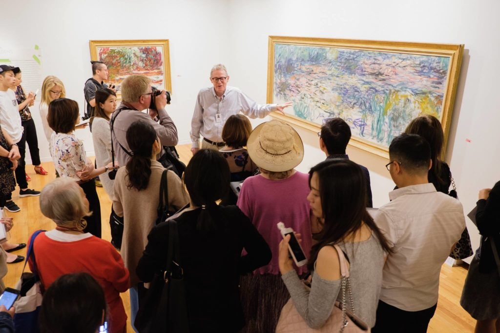 """More Canadians are visiting museums and galleries than ever, says a new study. This image shows Ian M. Thom, senior curator - historical of the Vancouver Art Gallery, at the media preview of the popular """"Claude Monet's Secret Garden"""" exhibition in 2017. Photo: Pardeep Singh via Vancouver Art Gallery Facebook Page."""